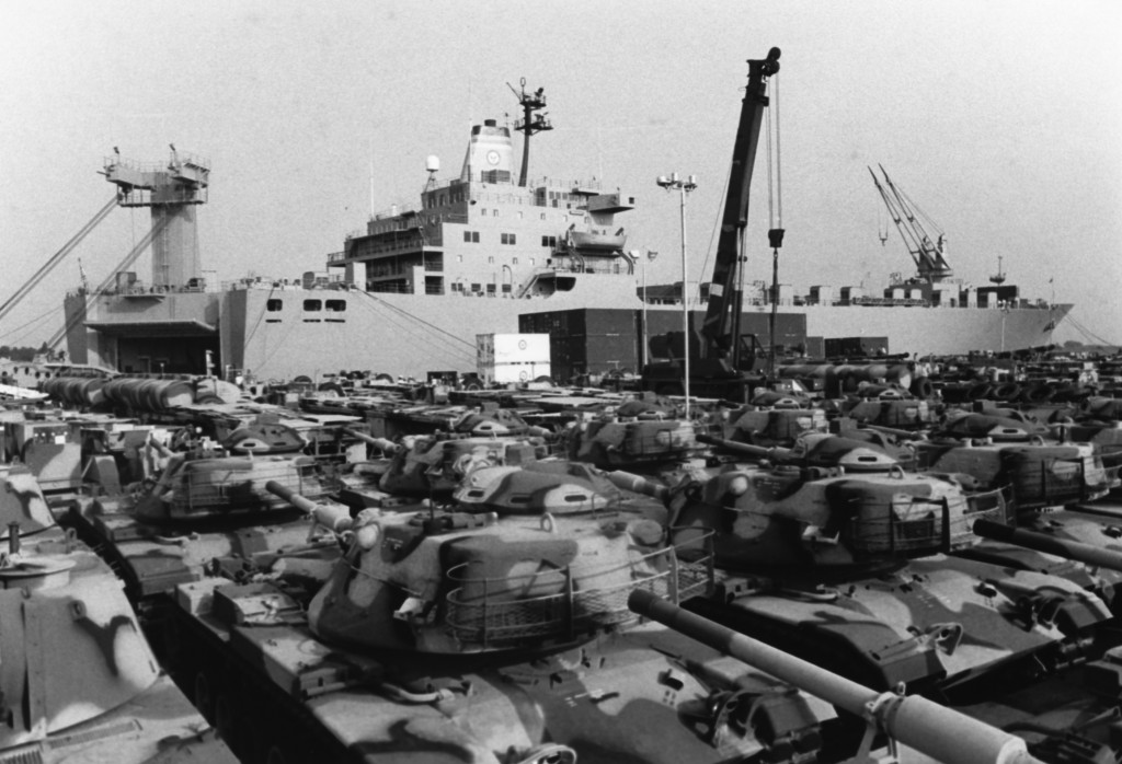 WILMINGTON, NC (July 3, 1980) U.S. Marine Corps' M-60A1 tanks await loading on USNS MERCURY (T AKR 11), a roll-on, roll-off ship of the Navy's Military Sealift Command, during Leading operations this week. (Photo by PH3 George Bruder, USN/DoD Image)