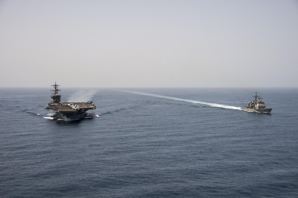 150421-N-ZF498-155 ARABIAN SEA (April 21, 2015) The aircraft carrier USS Theodore Roosevelt (CVN 71) and the guided-missile cruiser USS Normandy (CG 60) operate in the Arabian Sea conducting maritime security operations. (U.S. Navy photo by Mass Communication Specialist 3rd Class Anthony N. Hilkowski/Released)
