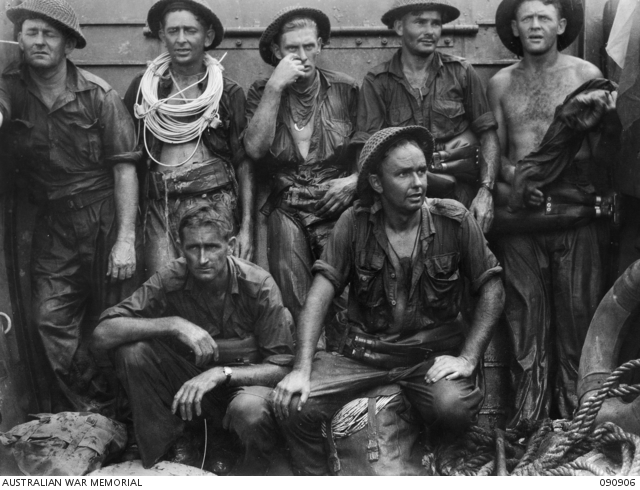 TARAKAN, BORNEO. 1945-04-30. MEN OF 2/13 FIELD COMPANY, ROYAL AUSTRALIAN ENGINEERS, EXHAUSED AFTER THE INITIAL ATTEMPT TO GET ASHORE AT LINGKAS TO BLOW WIRE DEFENCES. THEY REST IN A LANDING CRAFT VEHICLE-PERSONNEL BEFORE A LATER SUCCESSFUL ATTEMPT AT FULL TIDE. IDENTIFIED PERSONNEL ARE:- SAPPER J.F. WILLIAMS (1); SAPPER J.R. MUNRO, LATER KILLED IN ACTION ON SNAG'S TRACK (2); SAPPER J.A. HOFFMANN (3); SAPPER R.A.R. STEVENSON (4); LANCE-CORPORAL R.C. MACE (5); SAPPER D.R. BIDWELL (6); SAPPER C.J. FOLEY (7). (Australian War Memorial ID #090906)
