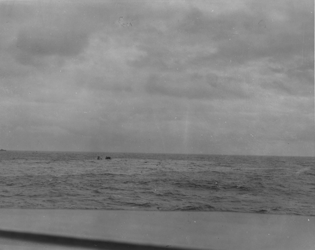 24 April 1945 - The USS Frederick C. Davis (DE-136) sinkin in the water of the North Atlantic after being hit by torpedo from the German sub U-546. Taken by a photographer of the USS Core (CVE-13) aboard the USS Neunzer (DE-150). (U.S. Navy Photo No. 323039)