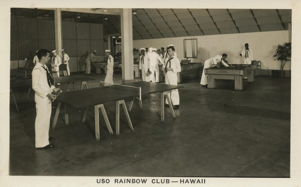 Sailors play ping-pong and shoot pool in the game room of the Rainbow Club.